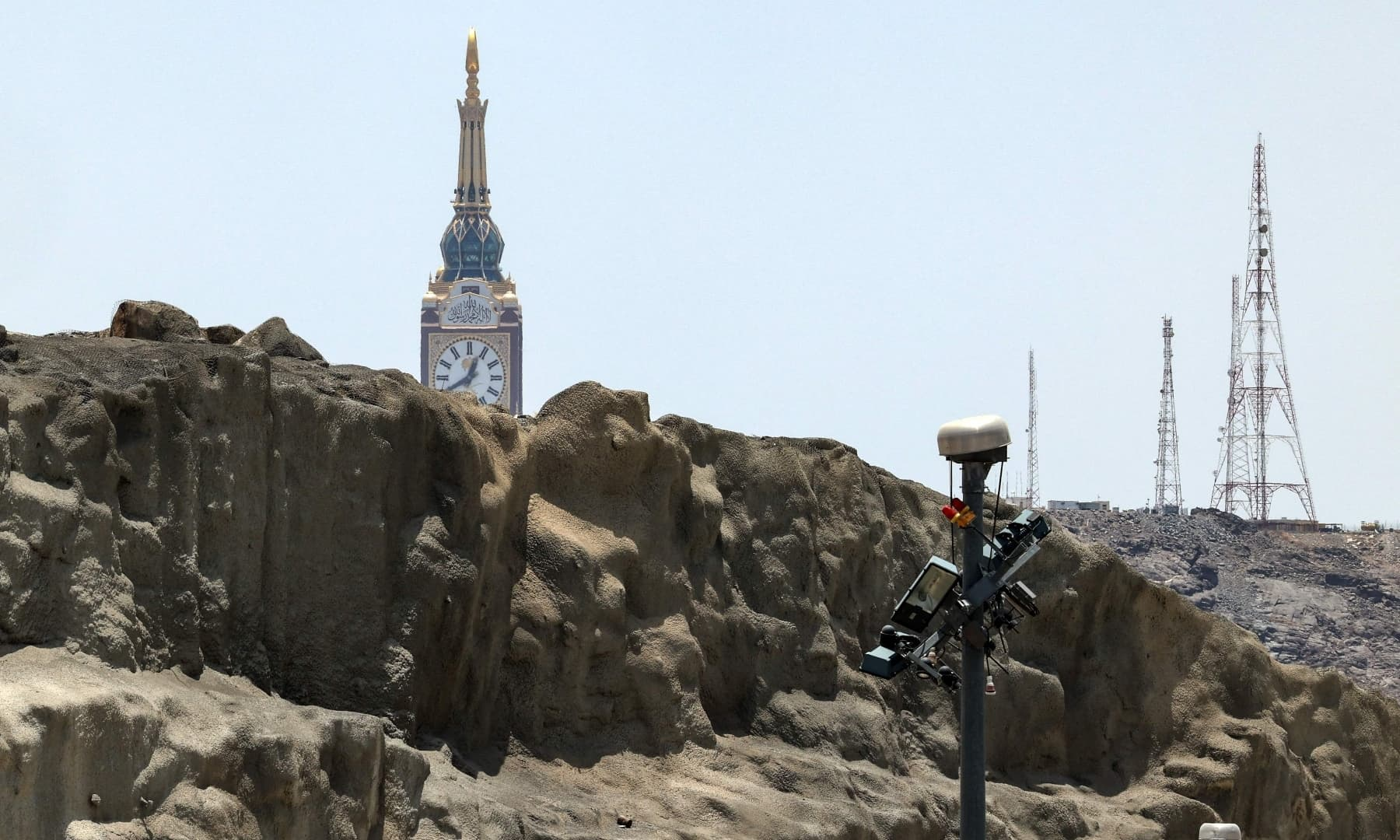 This picture shows a partial view of Mount Arafat, the tip of the Makkah Royal Clock Tower, and security cameras, southeast of the holy city of Makkah, Saudi Arabia, July 16, 2021. — AFP
