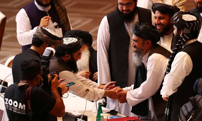 Taliban delegates shake hands during talks between the Afghan government and Taliban insurgents in Doha, Qatar on Sep 12, 2020. — Reuters/File