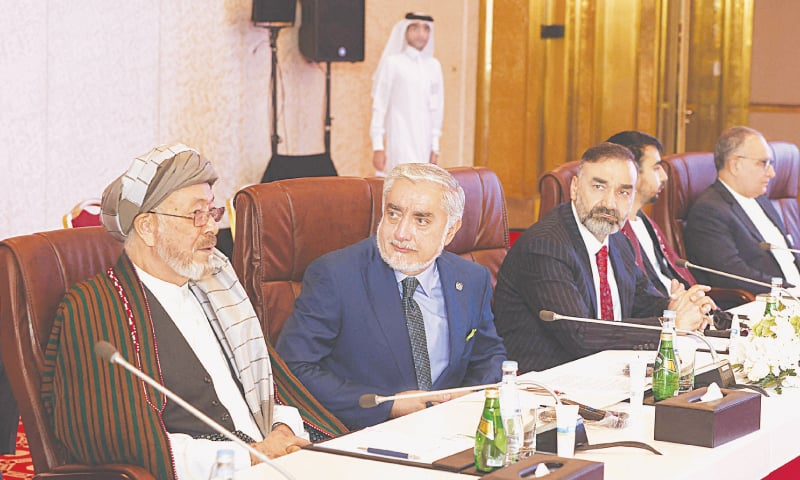 DOHA: Afghanistan's former chief executive Abdullah Abdullah attends a session of peace talks between the Afghan government and the Taliban on Saturday. (Right) Taliban leaders arrive for the meeting.—AFP