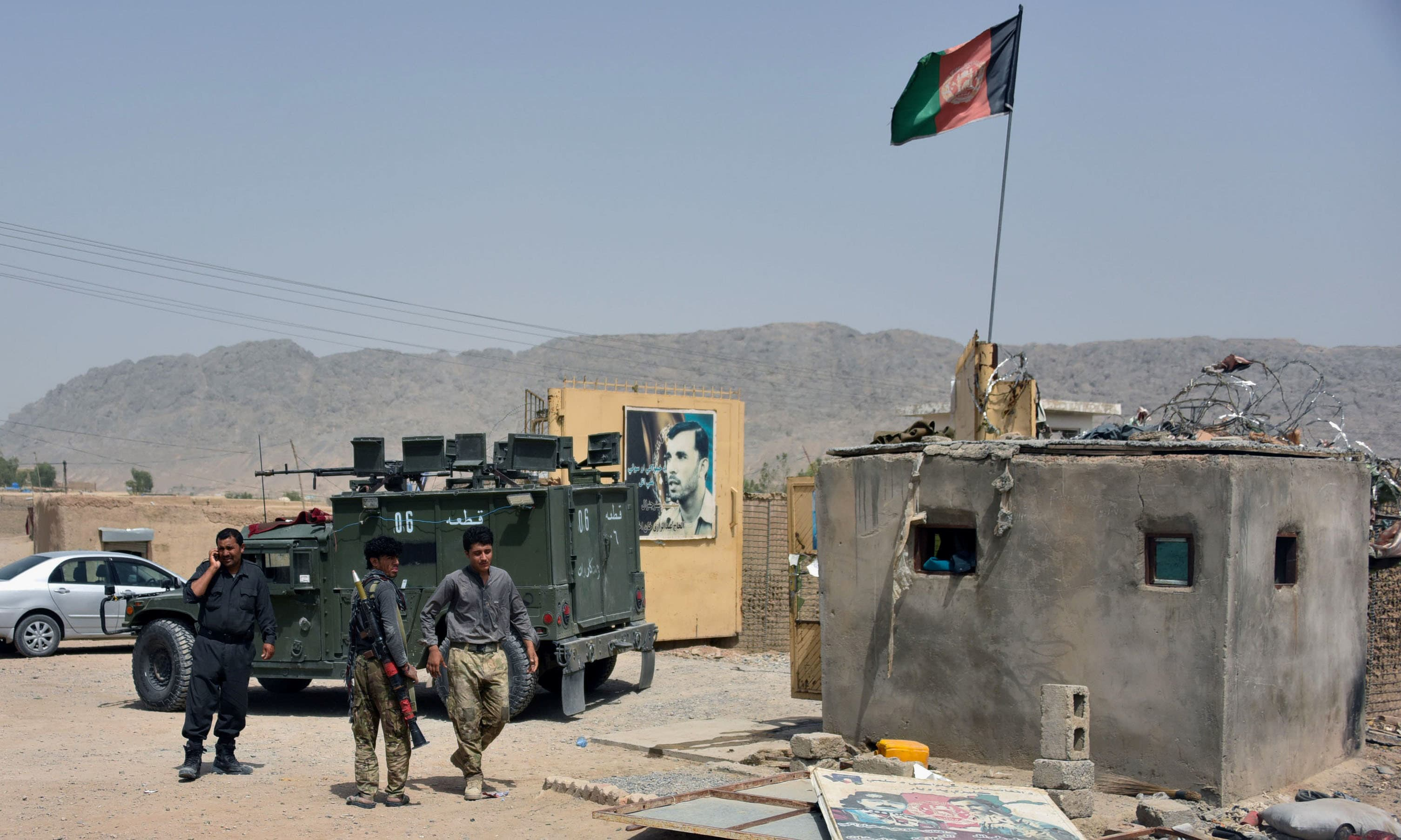 In this file photo, Afghan security forces inspect the site of a car bomb attack in Kandahar province, Afghanistan. — Reuters