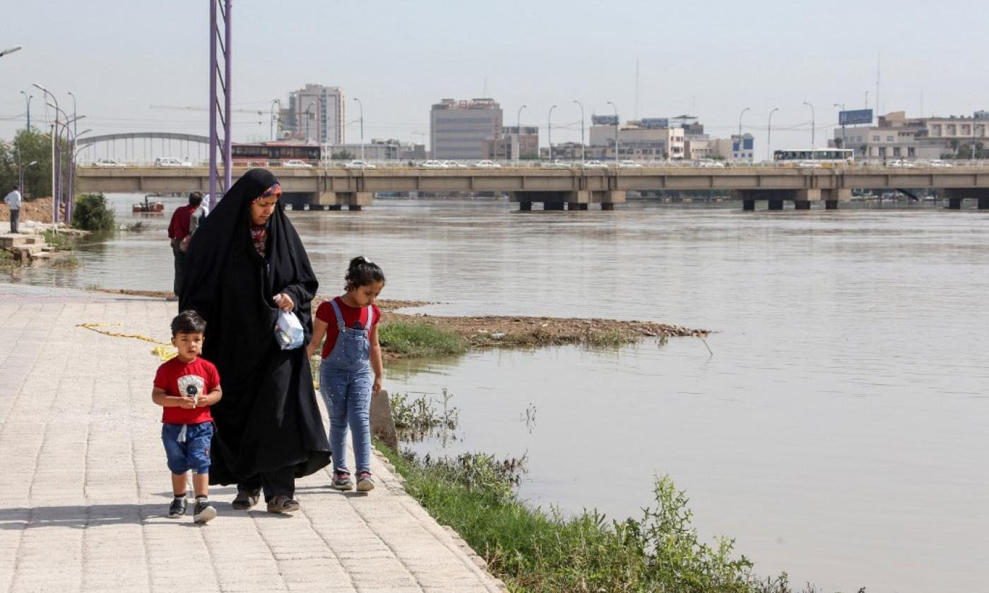 A woman walks with her children along the Karun River in Ahvaz, the capital of Iran's southwestern province of Khuzestan. — AFP/File