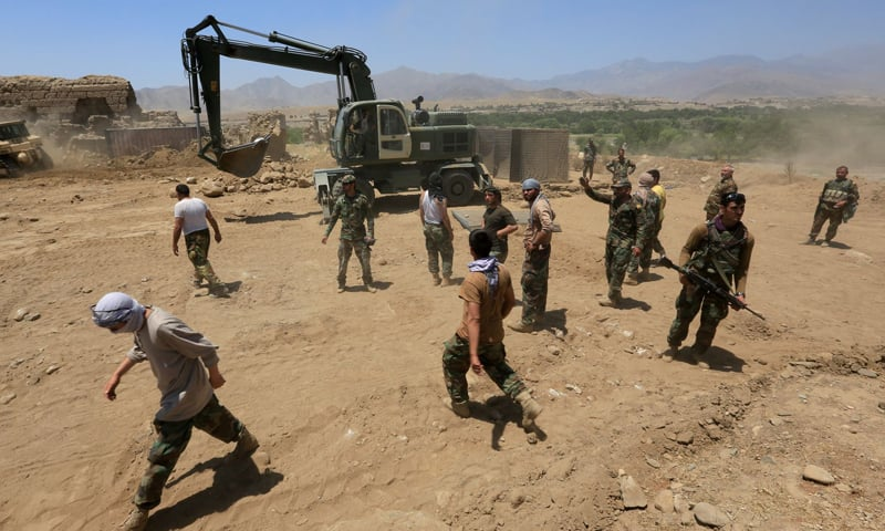 In this file photo, Afghan National Army soldiers are seen rebuilding a checkpoint recaptured from the Taliban, in the Alishing district of Laghman province, Afghanistan. — Reuters/File