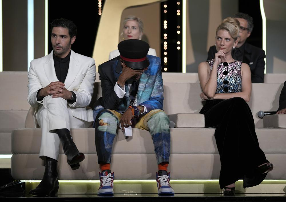 Jury president Spike Lee, center, holds his head in hands after accidentally revealing the film Titane as the winner of the Palme d'Or as jury members Tahar Rahim, left, Jessica Hausner, back center, and Melanie Laurent look on during the awards ceremony. — AP