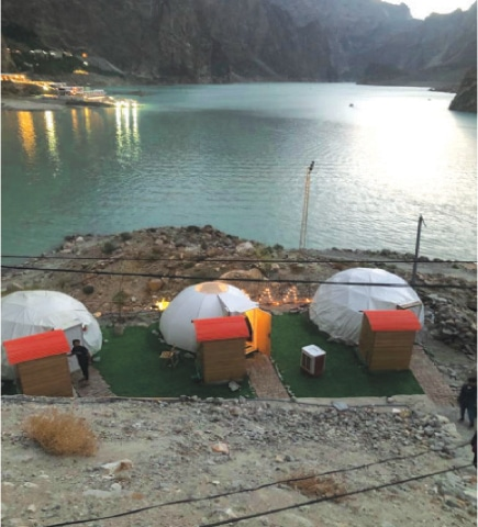 Sweet Tooth igloos overlooking the Attabad Lake.—Photo by Adil Marvi