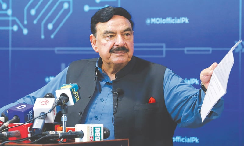 ISLAMABAD: Interior Minister Sheikh Rashid Ahmed gestures during a press conference on Sunday.—AP