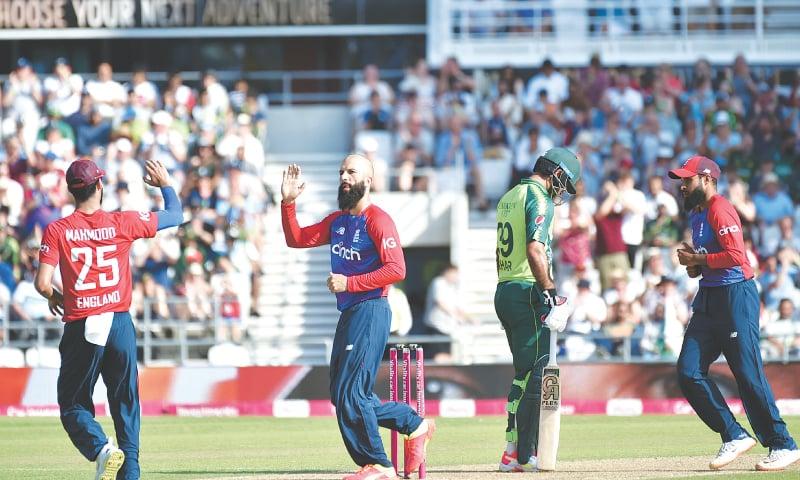 LEEDS: England all-rounder Moeen Ali (2nd L) celebrates the dismissal of Pakistan batsman Mohammad Hafeez during the second Twenty20 International at Headingley on Sunday.—AP