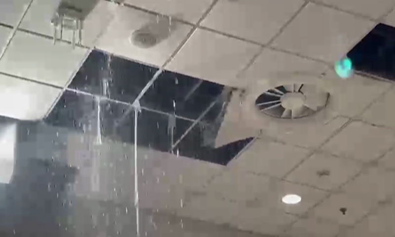 Rainwater falls down from the ceiling at Islamabad International Airport. — DawnNewsTV