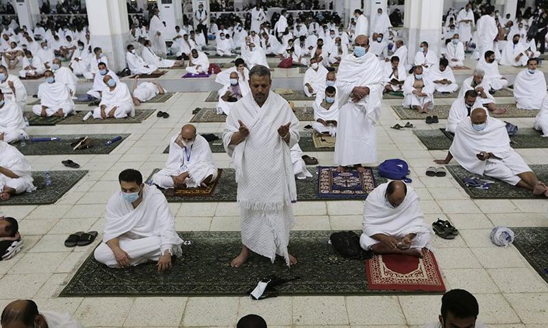 Pilgrims practise social distancing as they pray at the Namira Mosque in Arafat during Haj, near the holy city of Makkah, Saudi Arabia, Monday, July 19. — AP