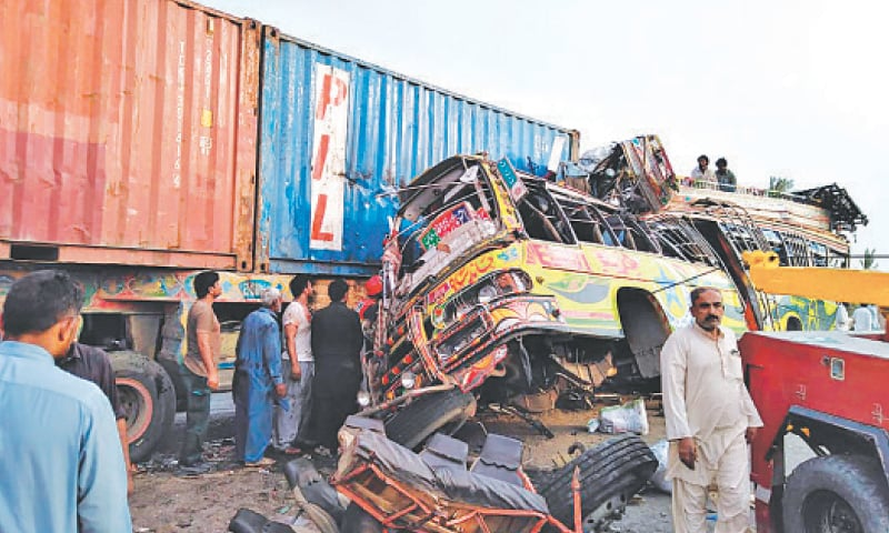 Injured people being taken out from the wreckage of the bus.—AP