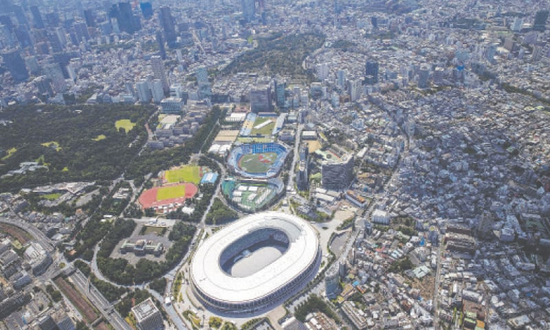 TOKYO: The Tokyo skyline and the Olympic Stadium, the main venue for the Tokyo 2020 Olympic Games, is seen in this aerial photo on Monday.—AFP