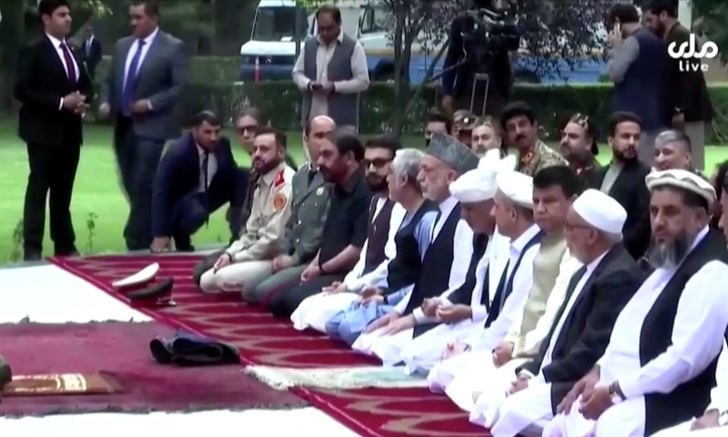 Afghanistan's President Ashraf Ghani attends Eid prayers at the presidential palace, moments after the sounds of rocket explosions were heard, in Kabul on July 20. — Reuters