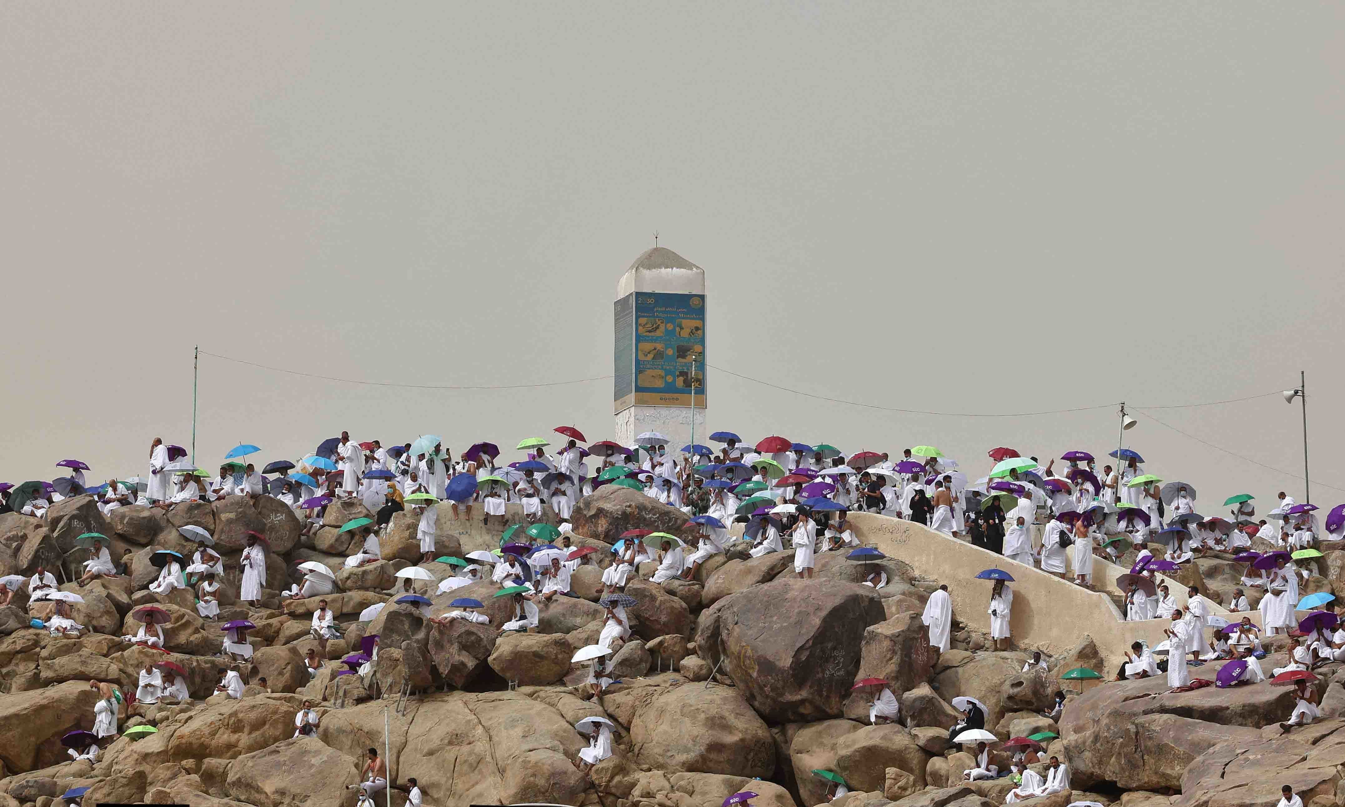 Muslim pilgrims gather around Mount Arafat, southeast of the holy city of Makkah, during the climax of the Haj pilgrimage amid the Covid-19 pandemic, on July 19. — AFP