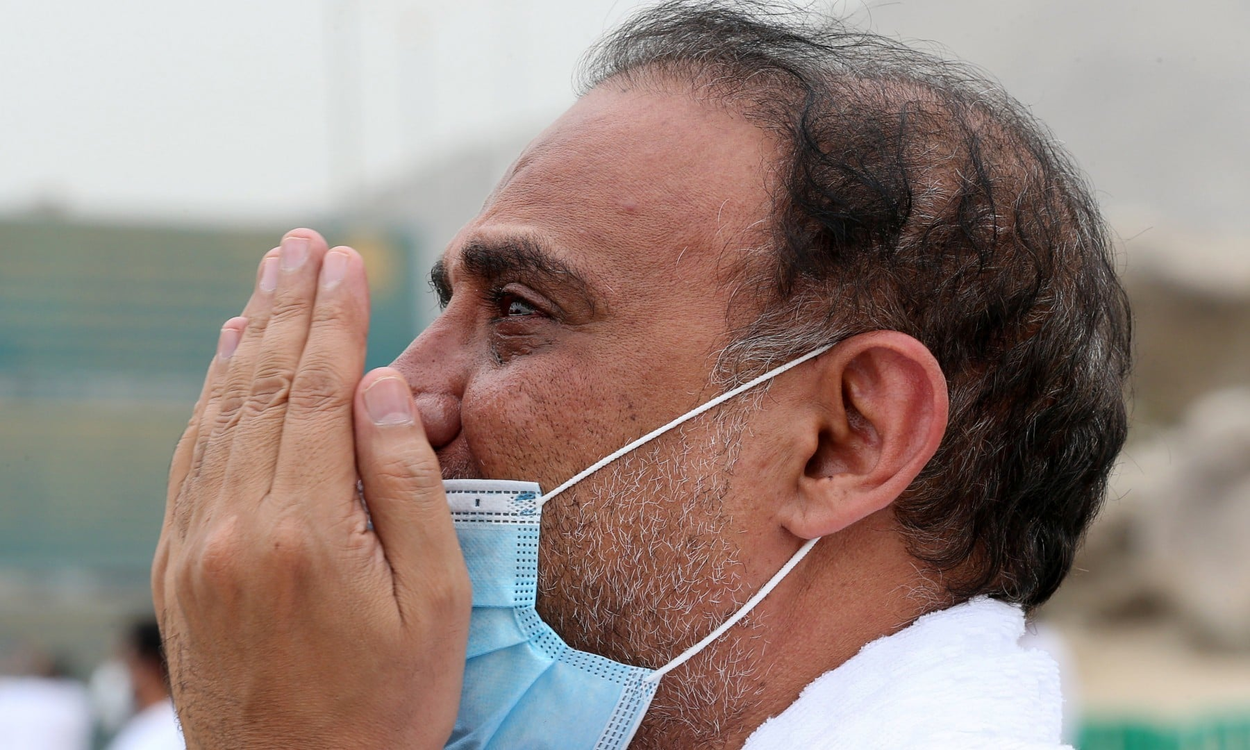 A Muslim pilgrim prays at the plain of Arafat during the annual Haj pilgrimage on July 19. — Reuters