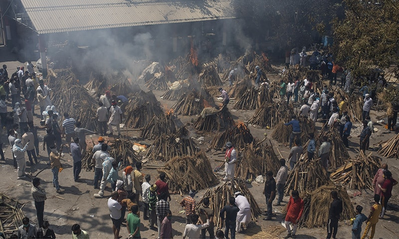 Multiple funeral pyres of those who died of Covid-19 burn at a ground that has been converted into a crematorium for the mass cremation of coronavirus victims, in New Delhi, India. — AP/File