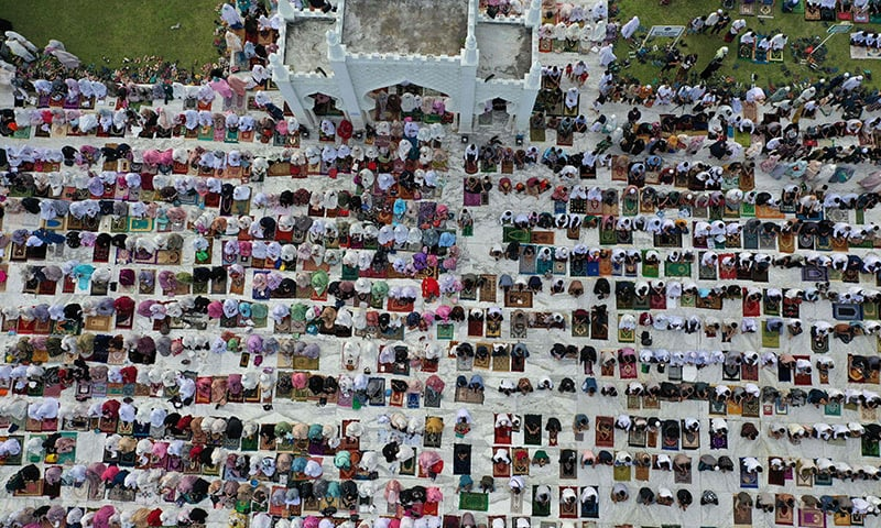 This aerial picture shows Muslims attending prayers to mark the Eidul Azha at the Baiturrahman Grand Mosque in Banda Aceh, Indonesia. — AFP