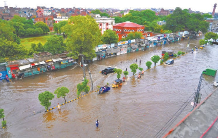 Circular Road near Bhatti Chowk flooded with rainwater creating problems for both motorists and pedestrians. The authorities concerned have failed to resolve this issue for long. — White Star / M. Arif