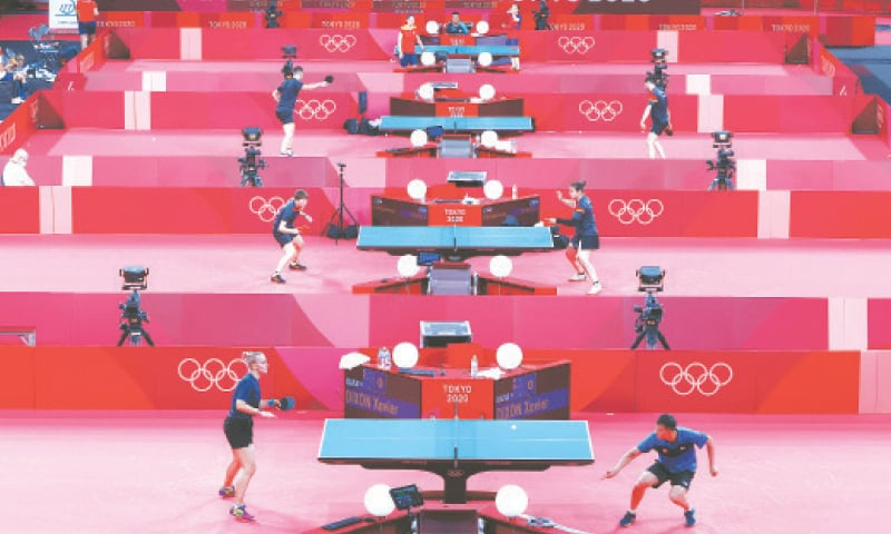 TABLE tennis players train at the Tokyo Metropolitan Gymnasium on Tuesday.—Reuters
