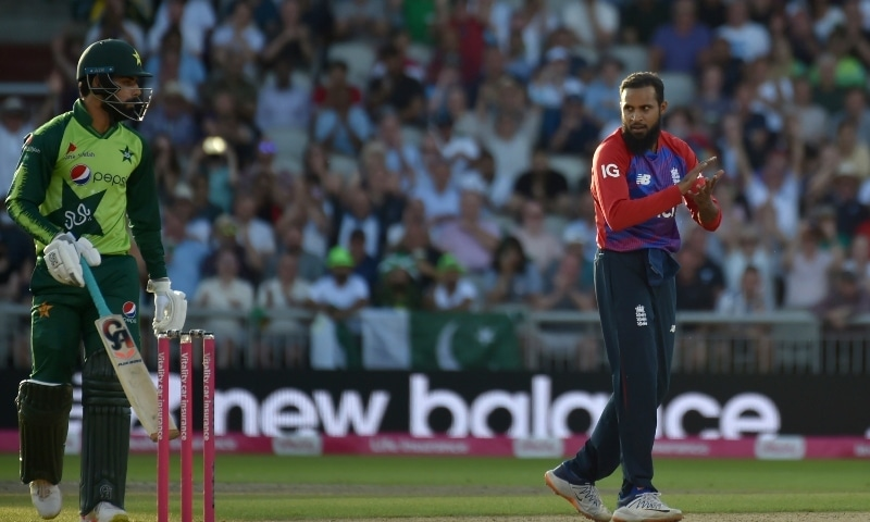 England's Adil Rashid, right, celebrates the dismissal of Pakistan's Shadab Khan, left, during the third Twenty20 international cricket match between England and Pakistan at Old Trafford in Manchester on July 20. — AP