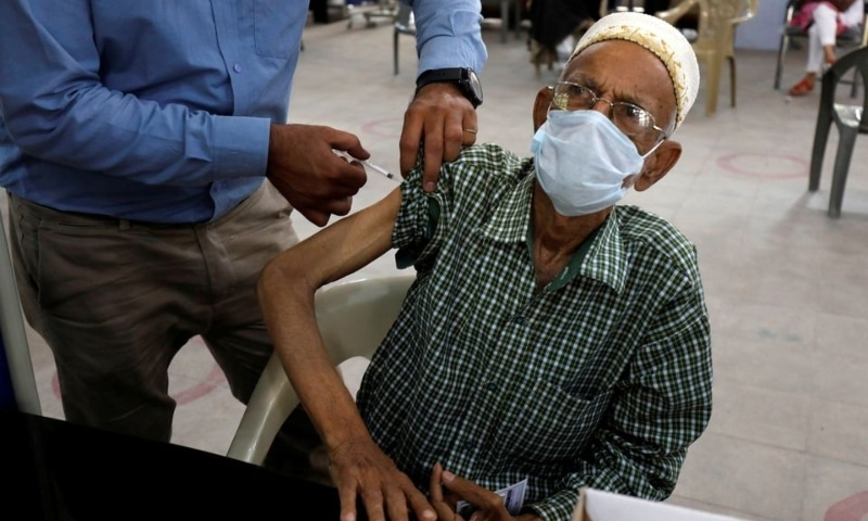 A resident receives a dose of the coronavirus vaccine, at a vaccination center in Karachi on March 22. — Reuters