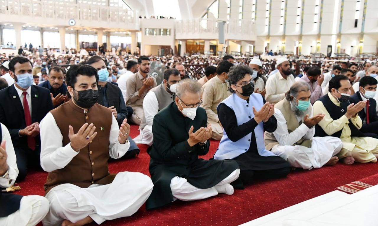 President Dr Arif Alvi (C), National Assembly Deputy Speaker Qasim Khan Suri (L) and Senator Faisal Javed Khan (R) offer Eidul Azha prayers at Faisal Mosque in Islamabad on Wednesday. — Photo courtesy President of Pakistan Twitter.
