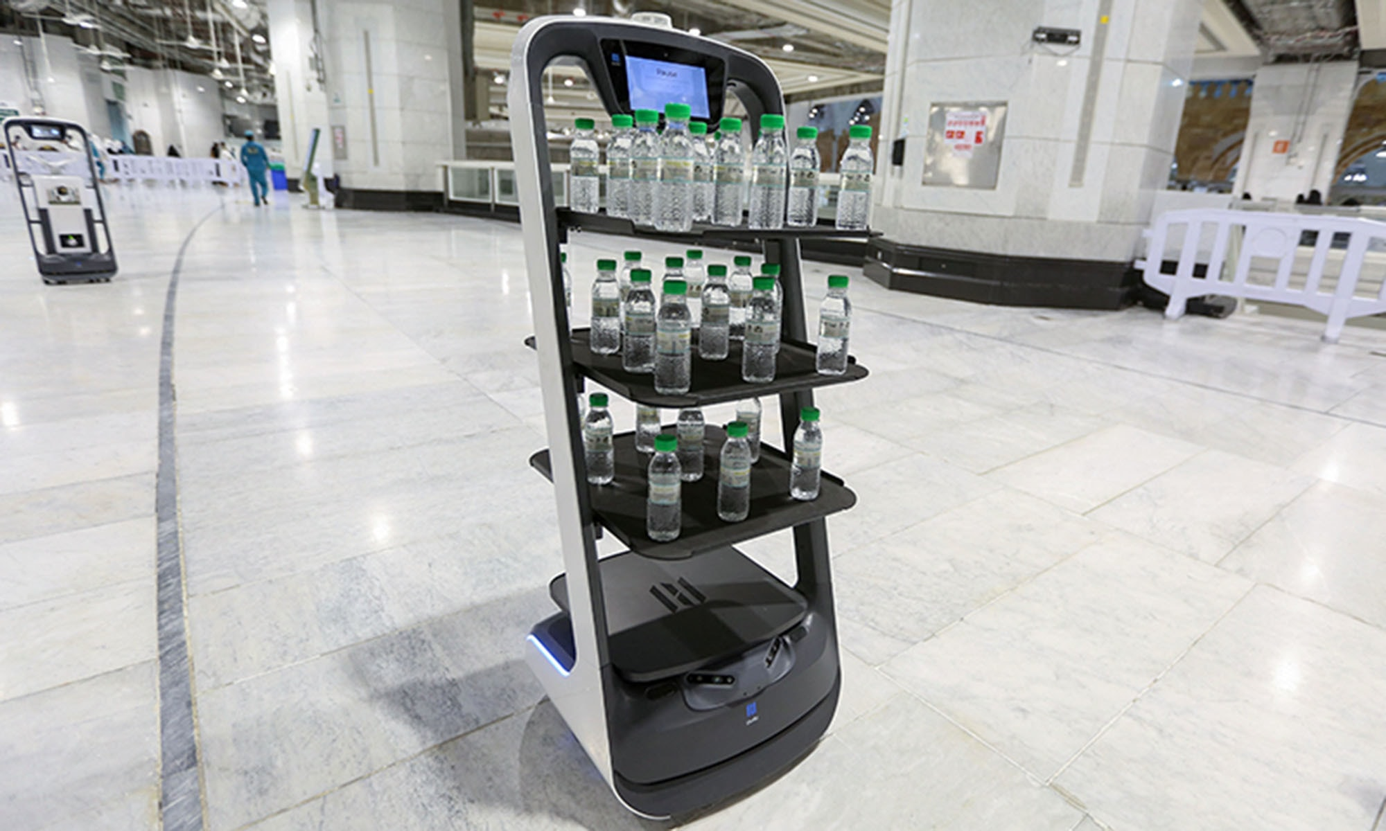 Picture shows a smart robot used for the first time at the Grand Mosque in Saudi Arabia's holy city of Mecca, supplying worshippers with bottles of Zamzam water to reduce direct contact with staff as a measure to prevent Covid-19 infections during the yearly Haj pilgrimage. — AFP/File