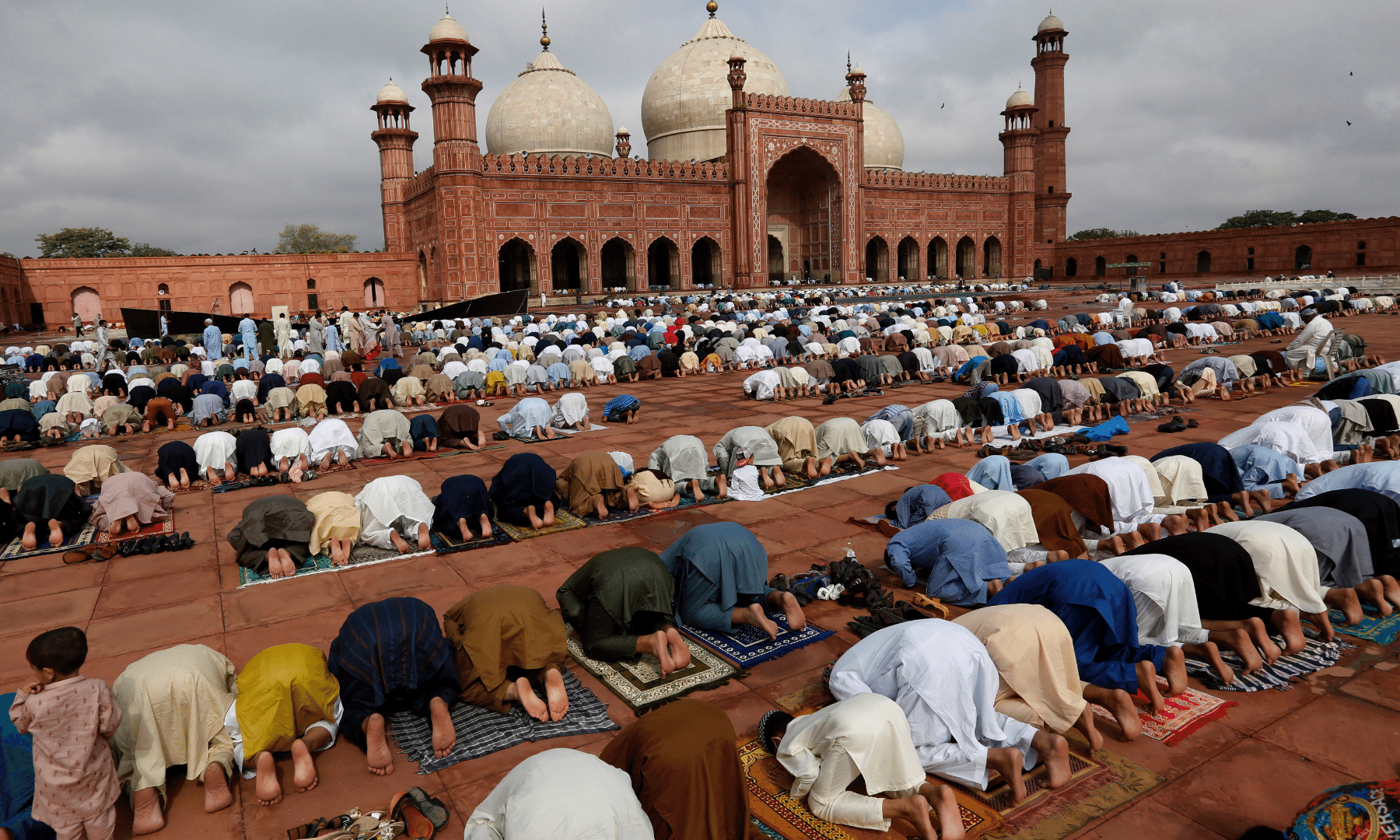 People attend Eidul Azha prayers at the historical Badshahi mosque in Lahore. — AP