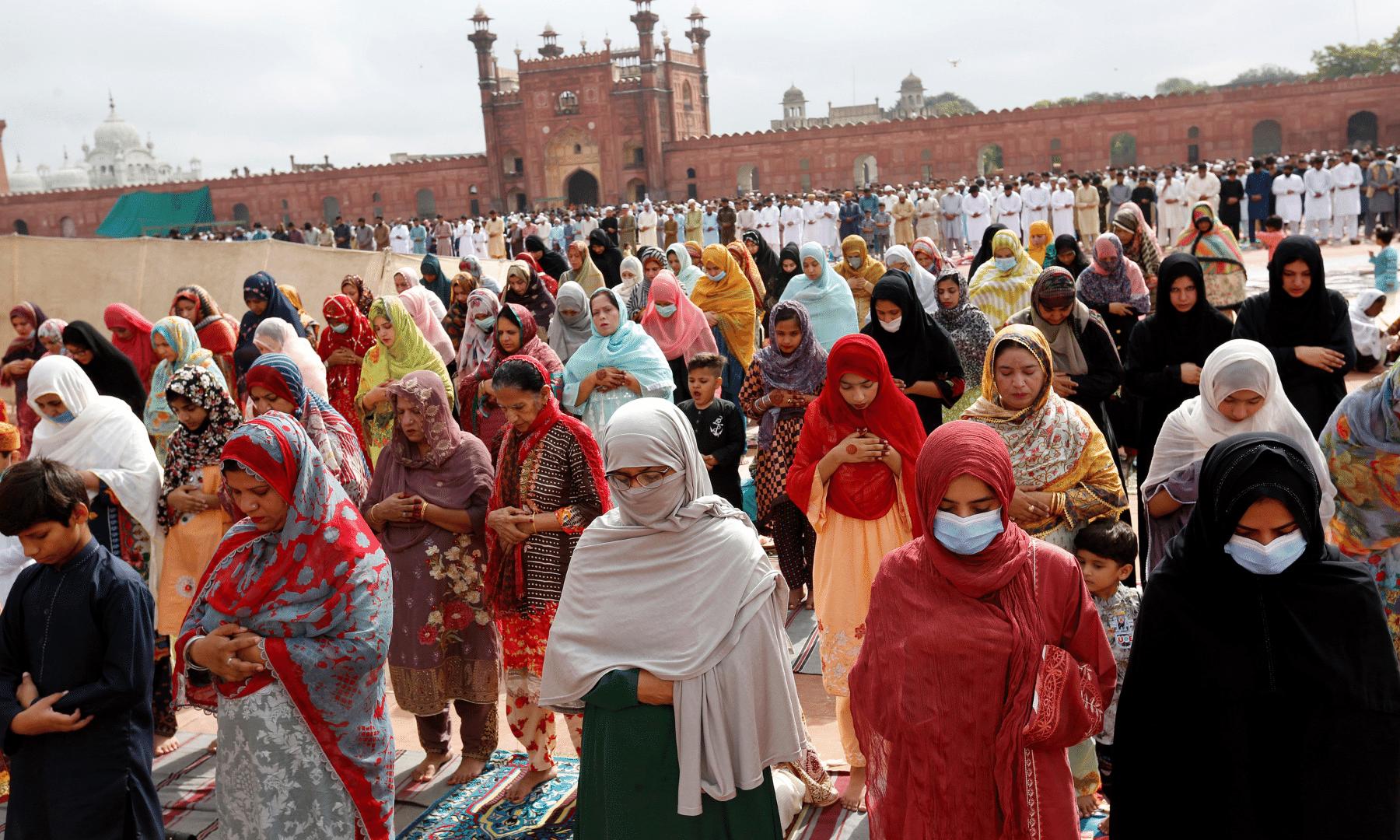 Women attend Eidul Azha prayers at the historical Badshahi mosque in Lahore. — AP