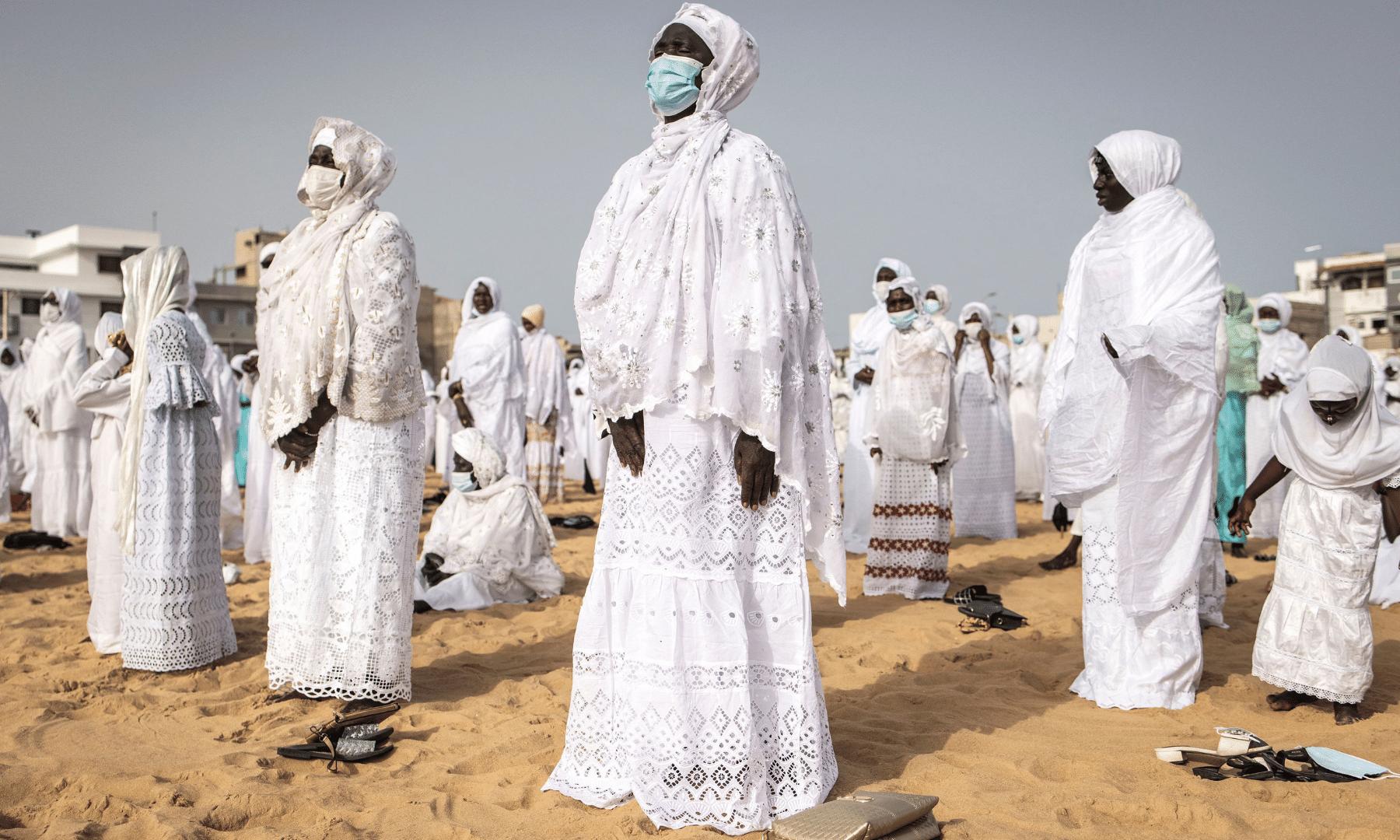 A follower of the Senegalese Layene community performs a prayer during Tabaski (Eidul Azha) celebrations in the popular neighbourhood of Yoff in Dakar. — AFP
