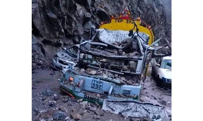 A vehicle damaged due to land sliding on the Karakoram Highway. — Photo by author