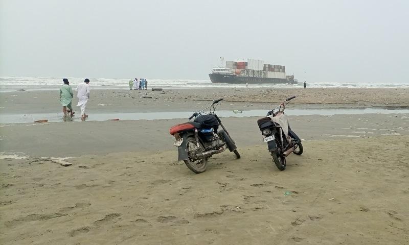 Beachgoers visit the site where the MV Heng Tong cargo ship is stranded on Sea View beach, Karachi. — Photo by author