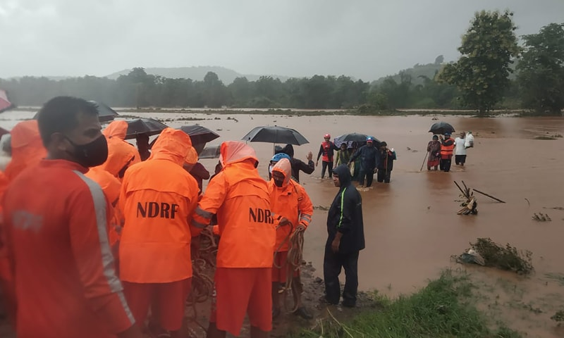 This photograph provided by India's National Disaster Response Force (NDRF) shows NDRF personnel rescuing people stranded in floodwaters in Chiplun, in the western Indian state of Maharashtra. — AP