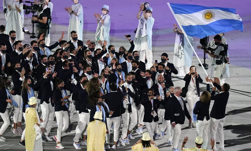 Cecilia Carranza Saroli and Santiago Raul Lange of Argentina (R) carry their country's flag during the opening ceremony in the Olympic Stadium at the 2020 Summer Olympics. — AP