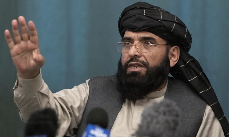 Suhail Shaheen, Afghan Taliban spokesman and a member of the negotiation team gestures while speaking during a joint news conference in Moscow, Russia on March 19, 2021.— AP/File