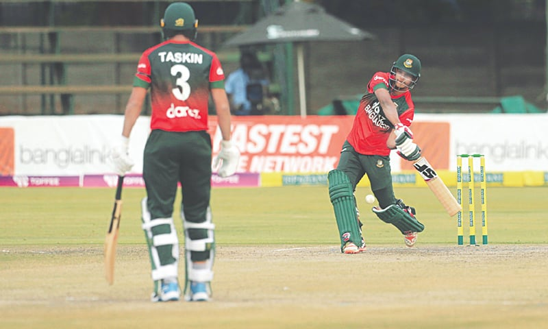 HARARE: Bangladesh tailender Mohammad Saifuddin hits out during the second T20 International against Zimbabwe at the Harare Sports Club on Friday. — AP