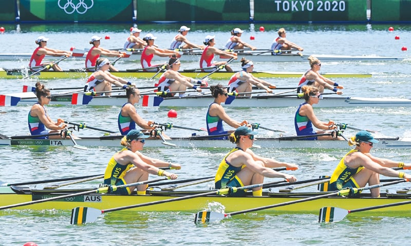 TOKYO: Teams compete in the women's quadruple sculls rowing heats at the Sea Forest Waterway on Friday.— AFP