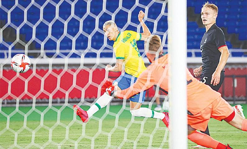YOKOHAMA: Brazil's Richarlison shoots to score during the Group 'D' match against Germany at the Yokohama International Stadium. — AFP