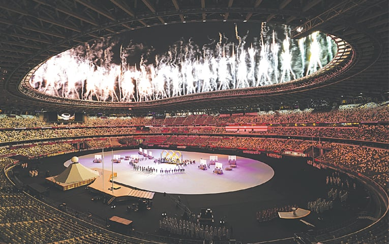 FIREWORKS explode during the opening ceremony at the Olympic Stadium on Friday.—AP