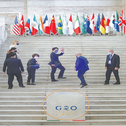 NAPLES: Japan's Environment Minister Shinjiro Koizumi salutes as he arrives to take part in a G20 meeting on environment, climate and energy on Friday.—AP