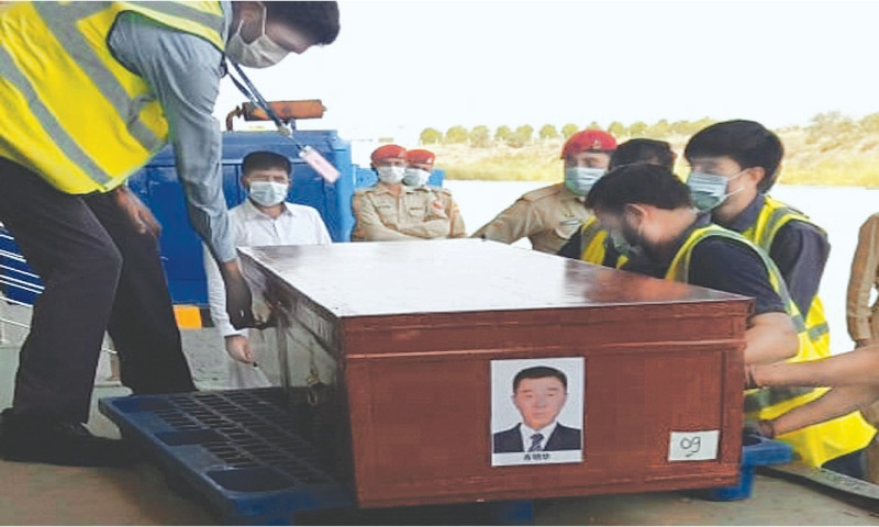 the coffin of a Chinese worker who died in the bus blast being brought to the Islamabad International Airport on Friday. — White Star