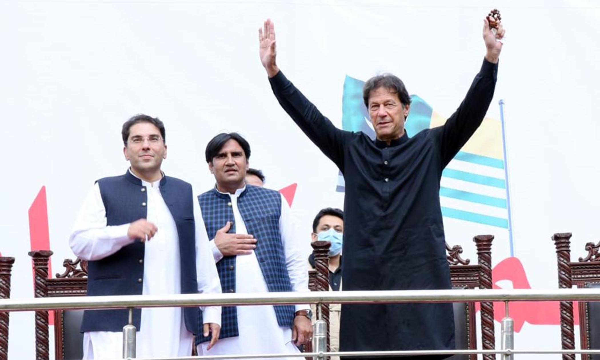 Prime Minister Imran Khan gestures during a rally in Azad Jammu and Kashmir's Tarar Khal on Friday. — PID
