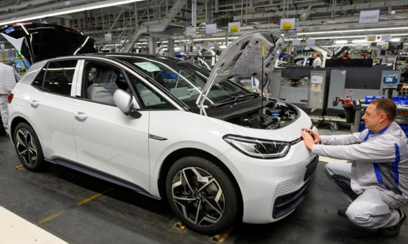 Employees work at a production line of the electric Volkswagen model ID.3 in Zwickau, Germany. — Reuters/File