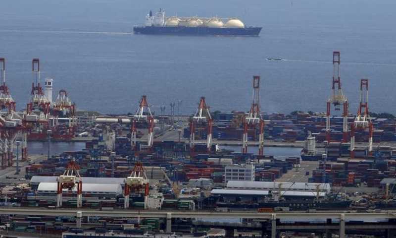 A LNG (Liquefied Natural Gas) tanker is seen behind a port in Yokohama, south of Tokyo, Japan. — Reuters/File