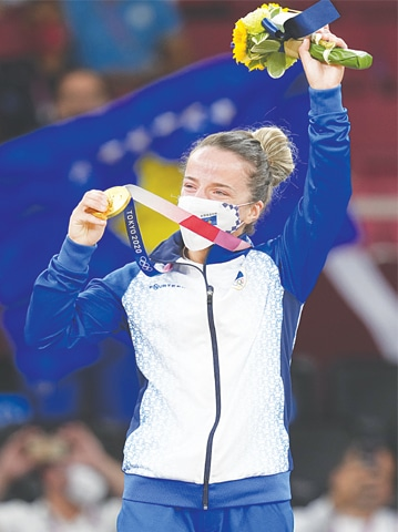 DISTRIA Krasniqi of Kosovo reacts during the medal ceremony for women's -48kg judo event at Nippon Budokan on Saturday.—AP