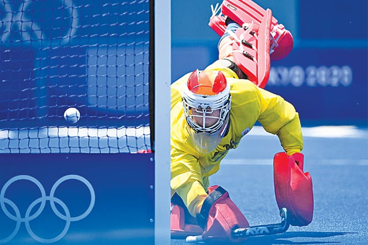 NETHERLANDS' goalkeeper Pirmin Blaak looks on as the ball goes into the net after a shot by Belgium's Alexander Robby Hendrickx (out of frame) during their men's Pool B match at the Oi Hockey Stadium on Saturday.—AFP