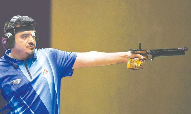 IRAN'S Javad Foroughi competes in the men's 10m air pistol final.—AFP