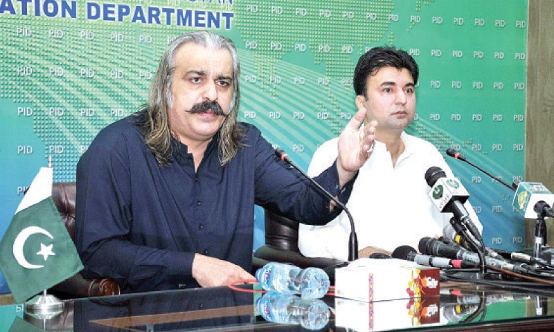 Minister for Kashmir Affairs and Gilgit-Baltistan Ali Amin Gandapur speaks at a press conference in Islamabad on Saturday. Communications Minister Murad Saeed is also present. — APP