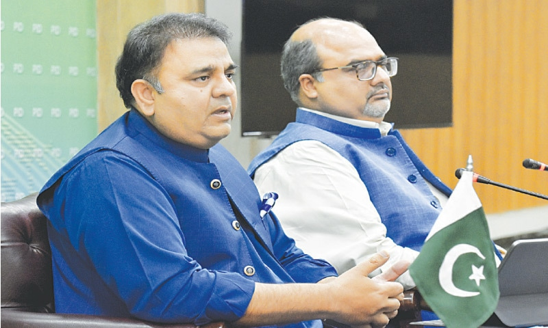 Information Minister Fawad Chaudhry and Adviser to the Prime Minister on Accountability Shahzad Akbar pictured at the press conference. — Tanveer Shahzad / White Star