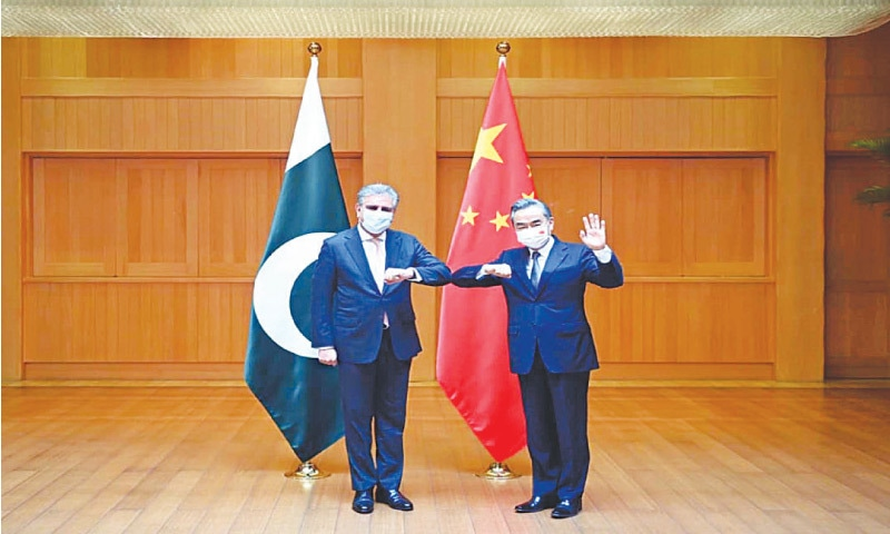 CHENGDU (China): Foreign Minister Shah Mahmood Qureshi pictured with his Chinese counterpart Wang Yi on Saturday. — PPI