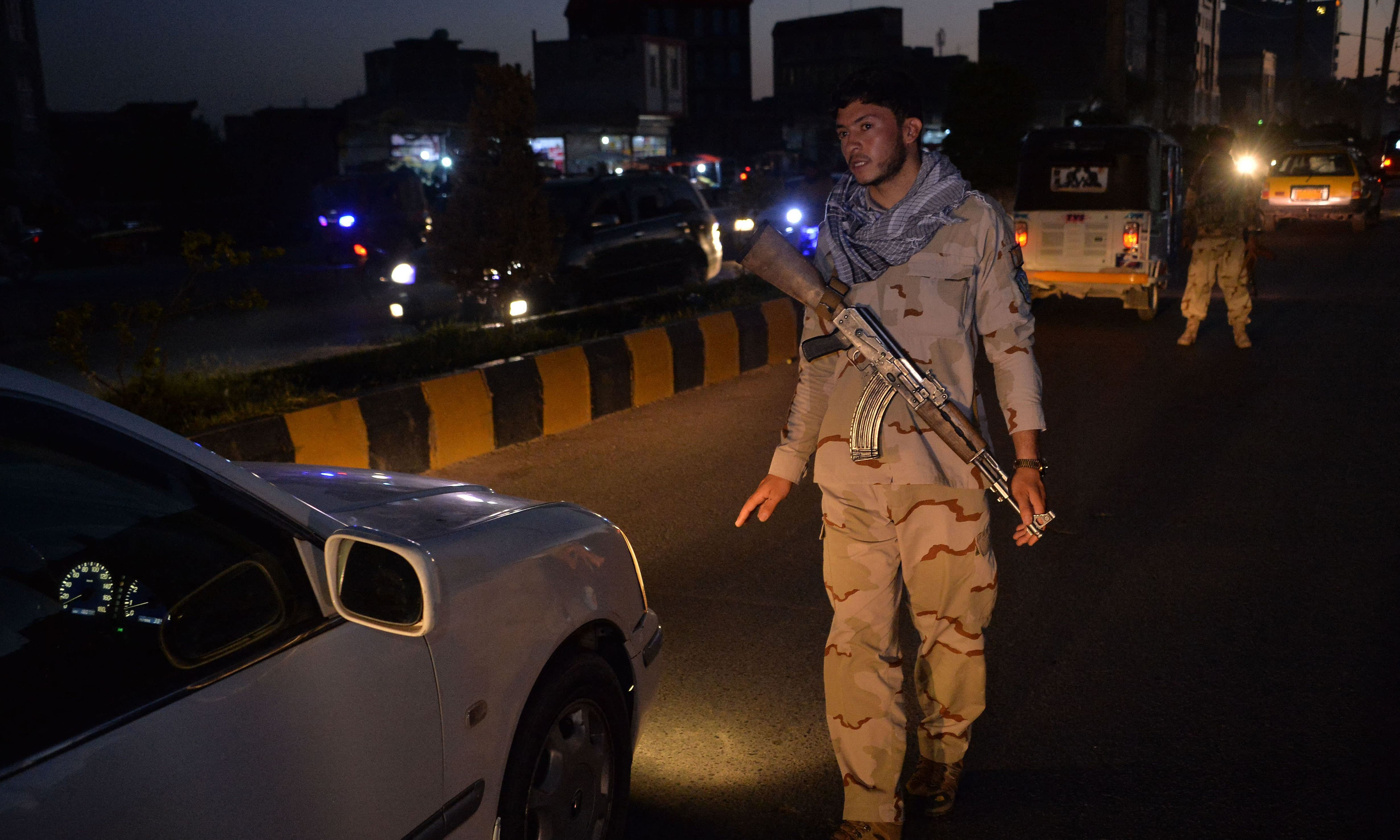 A security personnel stops a vehicle at a check point in Herat on Saturday, as a night curfew was imposed across 31 of the country's 34 provinces to curb surging violence unleashed by a sweeping Taliban offensive in recent months. — AFP