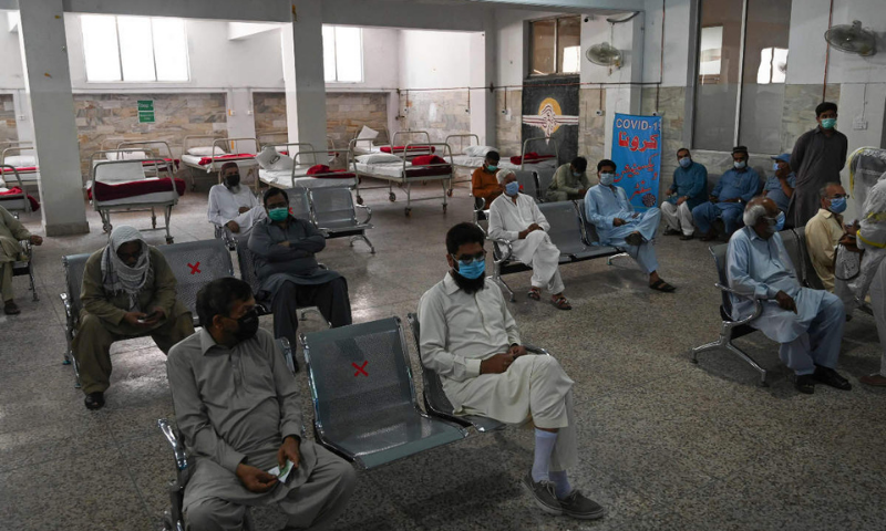 People wait for their turn to get the Sinovac vaccine at the Red Crescent vaccination centre in Rawalpindi. — AFP/File